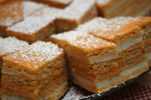 Layered honey cake can be sliced into squares and served at parties and as a dessert
