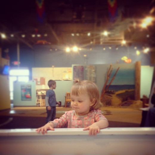 Cool off with the kids by splashing in the (air conditioned!!) hands-on water exhibit inside the Great Lakes Children's Museum.