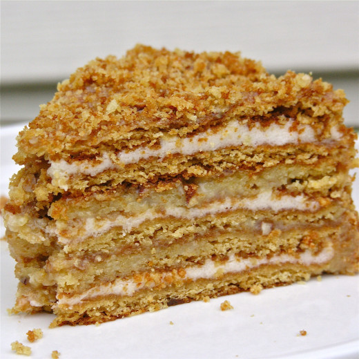 Layered honey cake with cream cheese filling, topped with almonds is a special treat
