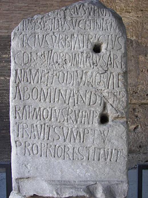 Latin inscription on the Coliseum