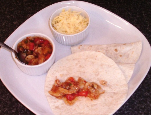 Fajitas spiced jellied cod spooned on to tortilla wrap