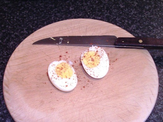 Hard boiled egg is seasoned with paprika