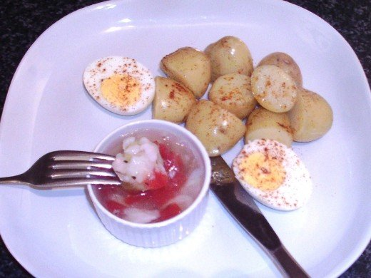 Paprika spiced potato is dipped in to jellied cod