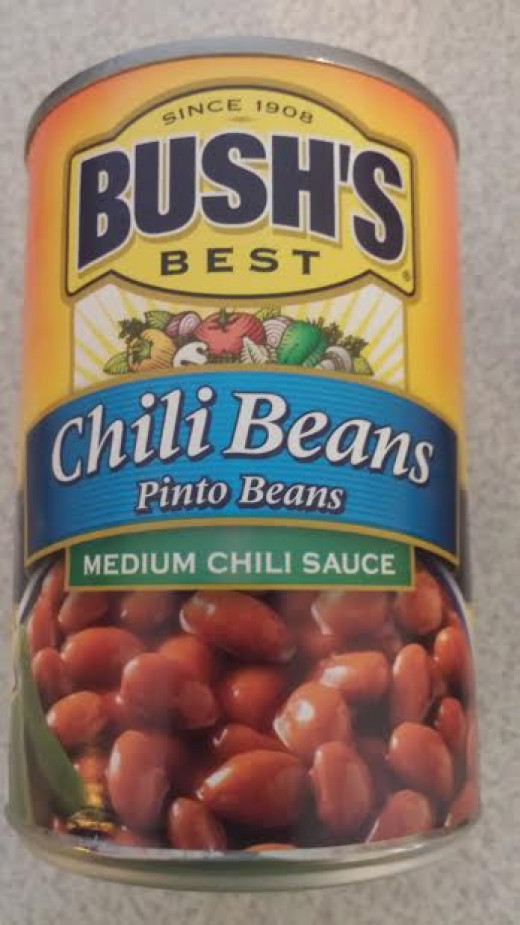 This is a Pinto Bean in a medium chili sauce.  It gives your salad a little bit of kick.  You can also find milder varieties and ones with different types of beans.  Experiment around and see what you like.