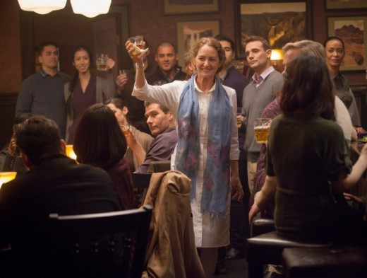 Pam makes a toast in the episode 4 of Wayward Pines.