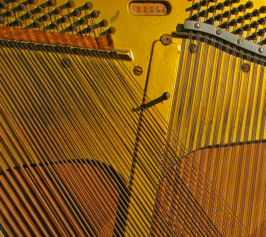 Piano strings are often overstrung with bass strings set at an angle and criss-crossing the rest of the strings. This gives added depth and power to the sound.