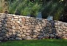 Although this picture has been taken from the internet, this is how a hybrid rock wall can look if built properly, and as explained in this text.