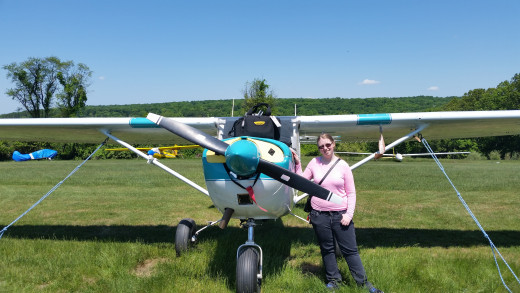 "Me next to the ""Barnestomer""- George's plane."