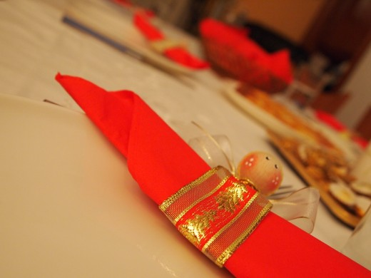 Ribbon fastened with a painted wooden bead makes a lovely napkin ring for Christmas