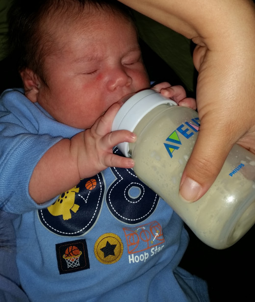 My son feeding with his Avent Classic bottle.