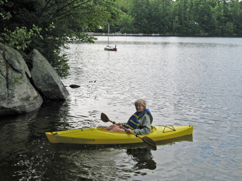 Kayaking on a lake near Sweden, Maine. Note that big rock.