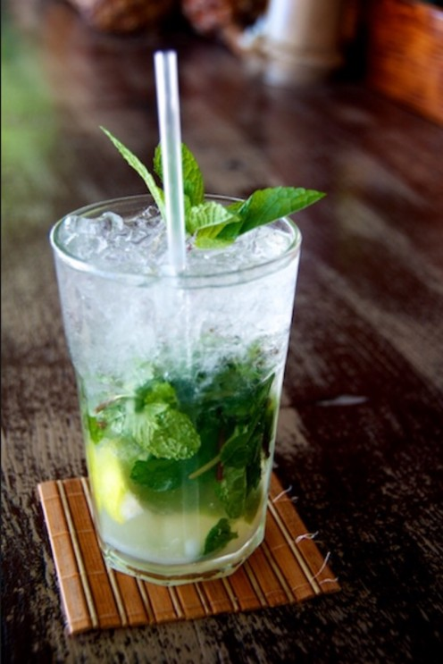 A muddled mix of Mint, Light Rum, Fresh Lime Juice, Simple Syrup, and Club Soda. Garnished with fresh Mint, and served on the rocks.