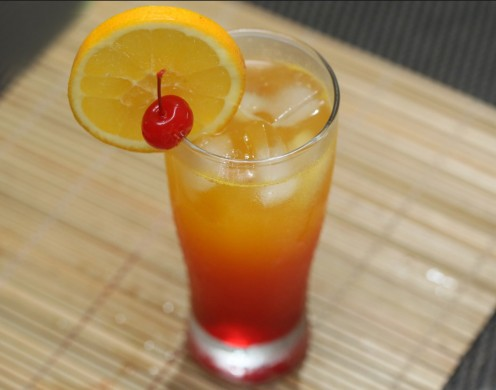 A kickin' combination of Tequila, and Orange Juice, finished with a splash of Grenadine, and served on the rocks.