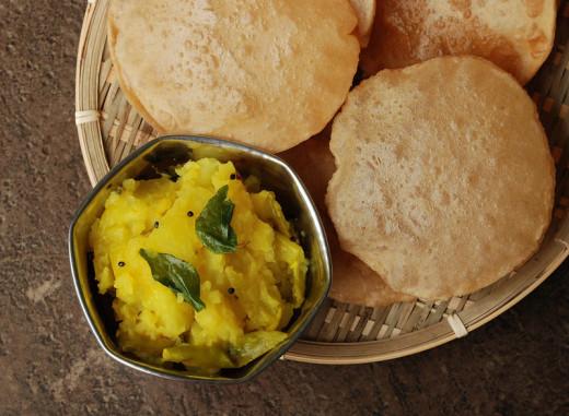 Plain Pooris served with dry aloo (potato) bhaji (subzi)