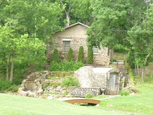 Cottage, fountain, well house, and bridge Springhouse garden