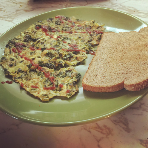 I like my kale omelet with a slice of toasted whole wheat bread.