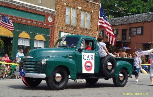 Nothing beats an antique truck to add to the fun of a 4th of July parade.