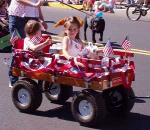 The cute kiddo's are having themselves a ball in their annual July 4th parade.