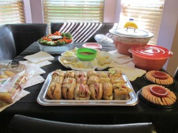 A beautiful array of appetizers from dips, chips and sandwiches.
