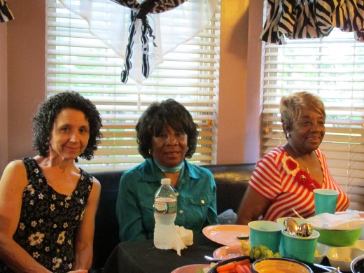 Aunts Mary on the left, aunt Janie and aunt Lois assist with preparation of the food.