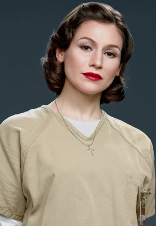 Lorna- ultra feminine girl in prison for her obsession with a man she went on one date with, and stalked he and his wife for years.  Also, she was busted for credit card fraud- but character is so sweet, lovable and kind