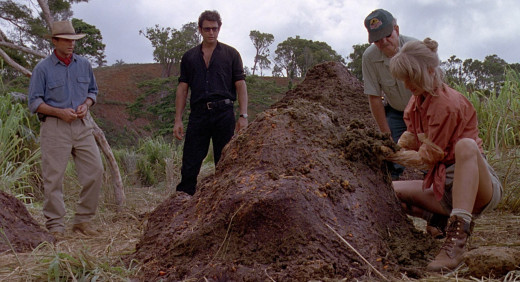 Sam Neill and Jeff Goldblum watch Jurassic Park III...Oh, wait...They're watching Laura Dern dig through Triceratops dung.