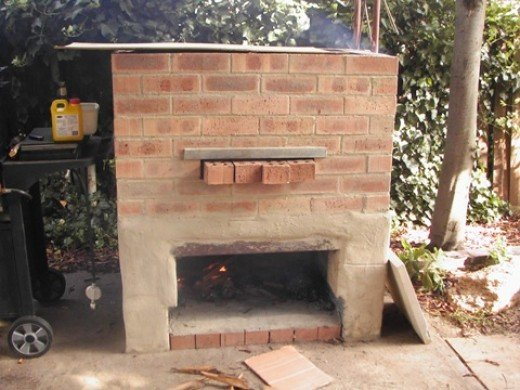 Here's my smoke house I bricked up, it's pretty basic with a fire at the bottom and a sheet of ply on top which I move around to give the best fire.