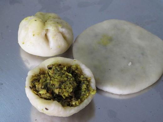 Filling the kachori dough