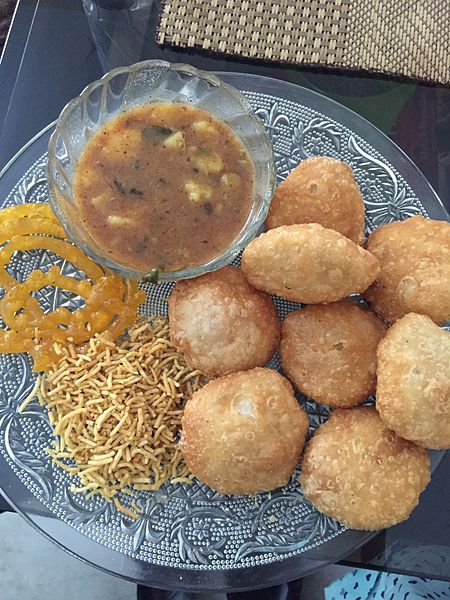 Kachoris served with potato gravy, sev and jalebi