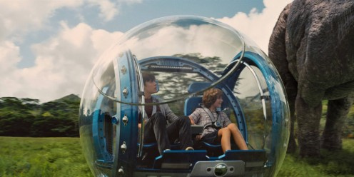 Zach (Nick Robinson) and Gray Mitchell (Ty Simpkins) pass an Apatosaurus as they tour the island's plains via gyrosphere.