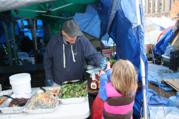 My daughter bringing a donation to the food tent at Occupy Boston.