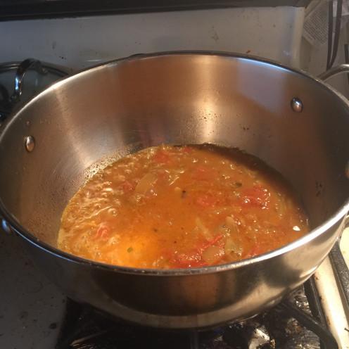 Cooking red chori in a pot.