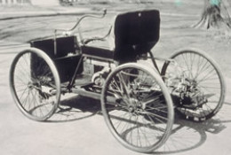 A rear view of the Quadricycle. Note the buggy design and large wheels.