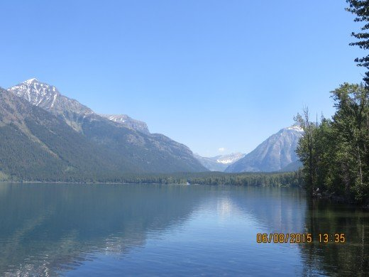 LOOKING NORTH ON LAKE McDONALD TOWARD MT. VAUGHT ON FAR LEFT, THEN MCPARKLAND, MT., THE GARDEN WALL IN THE CENTER, AND MT. CANNON ON RIGHT