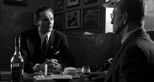 Liam Neeson As Oskar Schindler And Ben Kingsley As Itzhak Stern