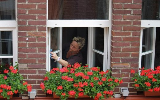 A woman cleaning her window.