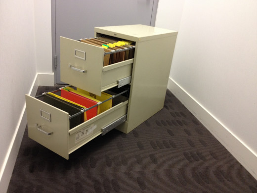 Metal file cabinet with open drawers, similar to theirs while they clear their desks.