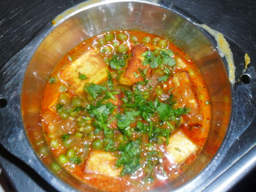 Matar Paneer garnished with coriander leaves