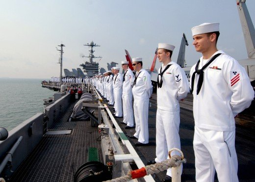 Sailors at attention on an amphibious flight deck