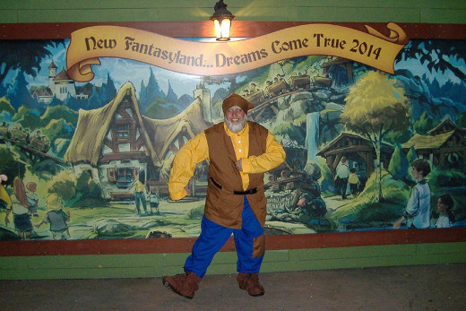 The author in front of the sign for the Seven Dwarfs Mine Ride, which was still under construction at the time