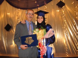 My father and I on my high school graduation day.