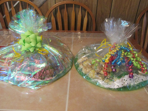 Two trays wrapped up and ready to go.  One of them has the chocolate chip cookies and chocolate pepper cookies.