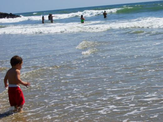 Children swimming in the ocean.