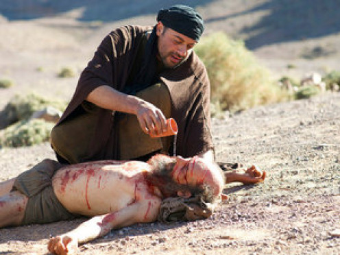 The Samaritan soothed his wounds with olive oil and wine and bandaged them.