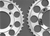 Rounded teeth on sprockets