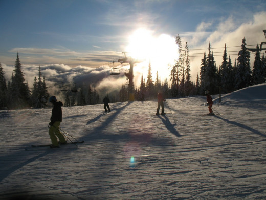 Skiers enjoying the slopes at Sun Peaks Resort in British Columbia.