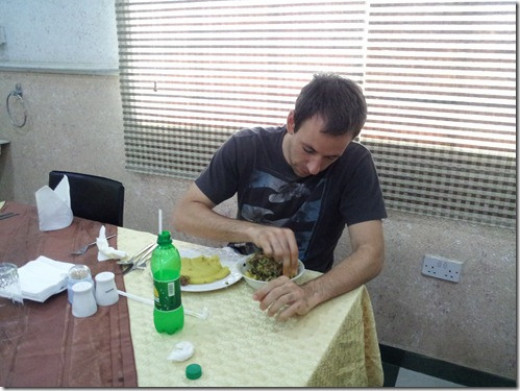 A foreigner enjoying Egusi soup with Eba