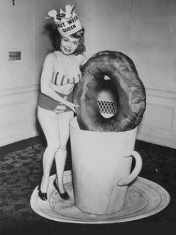 Retro beauty doing an ad for doughnuts and coffee.