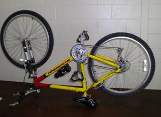 A bicycle turned upside down in order to remove the punctured tube.