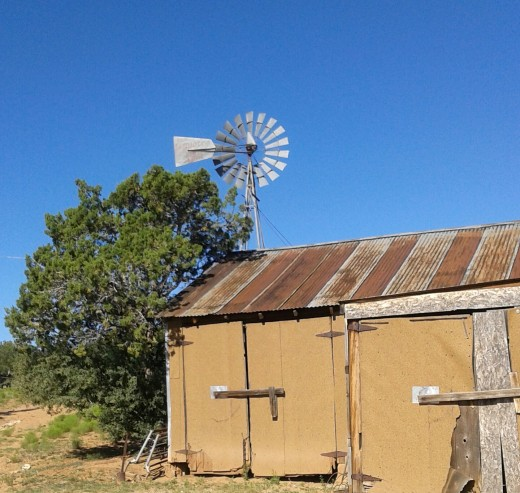 Windmill and tractor shed ruins on the old homestead
